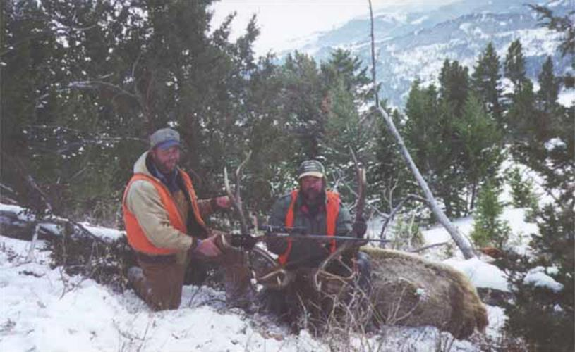 hunters with elk