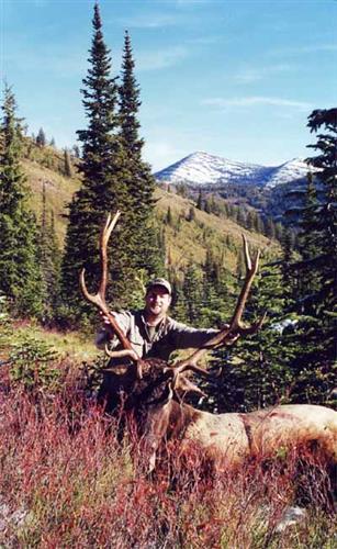 hunter with elk rack