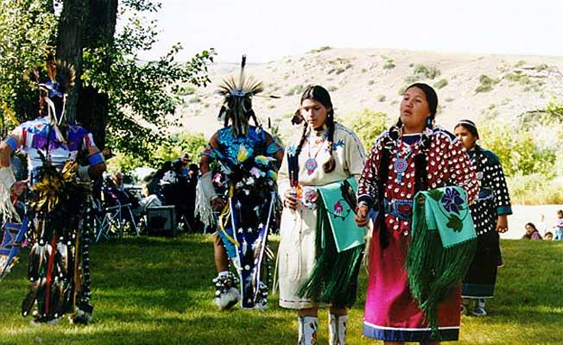 young Crow ladies preparing to dance