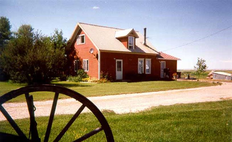 Exterior of house w/wagon wheel