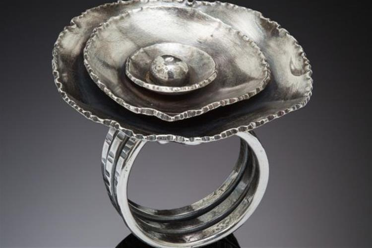Jewelry by Susie Frances Aoki is on display