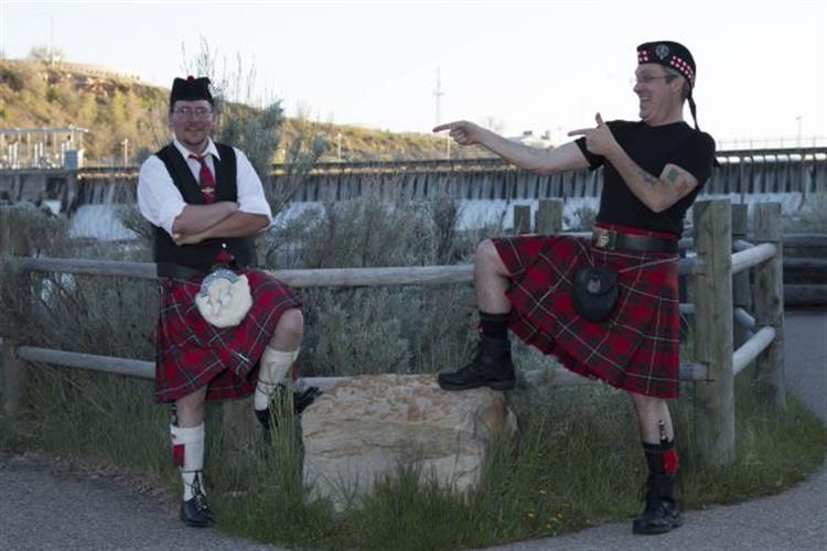 Tim Stoddard (left) and Paul Skinner (right) pose in front of Black Eagle Falls. Stoddard and Skinner decided to bring Celtic games  to Great Falls after enjoying many similar events around Montana.
