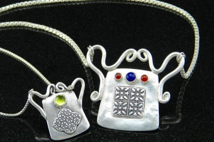 Apirit lock necklace is made of fine silver, sterling silver, carnelian and lapis lazuli.
